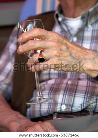 a wineglass in old hands