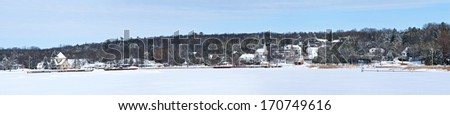 A winter panorama of the picturesque village of Ephraim on the shore of Eagle Harbor in Door County, Wisconsin. - stock photo