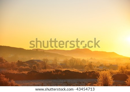 A Winter sunrise over mountains - stock photo
