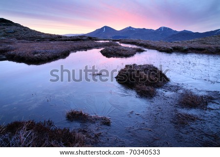 A winters dawn in the north of Loch Lomond and the Trossachs National park, looking towards Chabhair. - stock photo