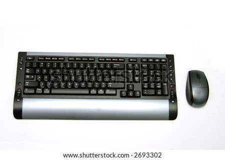 A Wireless keyboard and a wireless mouse  isolated against a white background - stock photo