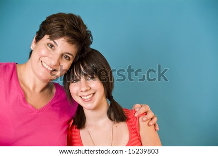 A woman and a girl representing a happy mother and daughter. (blue screen) - stock photo