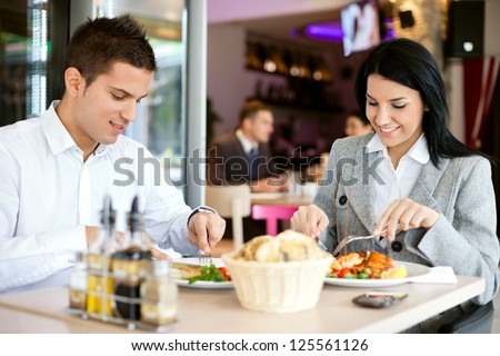 A woman and a man on a business lunch in a restaurant - stock photo