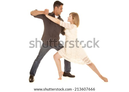 a woman and man dancing looking into each others eyes. - stock photo