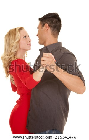 A woman and man looking into each others eyes dancing. - stock photo