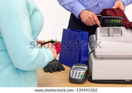 A woman at the store checkout  buying some gifts for a man - stock photo