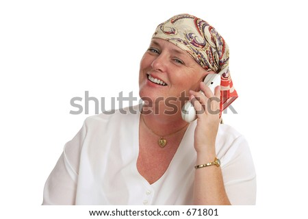 A woman, bald from medical treatment, receiving good news by telephone. - stock photo