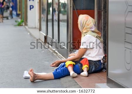 A woman beggar asking for money in Skopje, Macedonia - stock photo