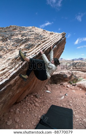 A Woman Bouldering in Red Rocks, Nevada - stock photo