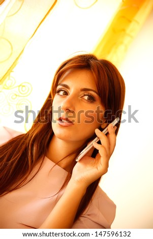 A woman calling someone on a smartphone.