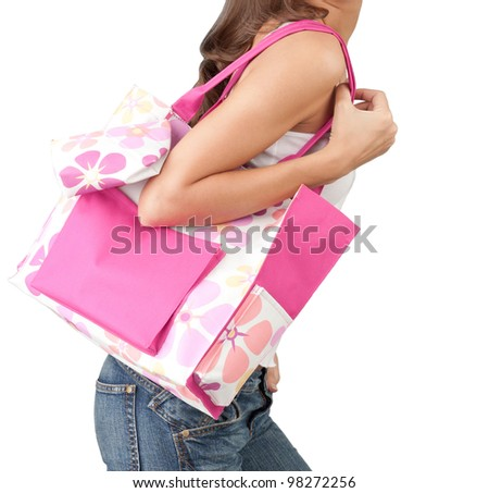 A woman carrying a pink handbag - stock photo