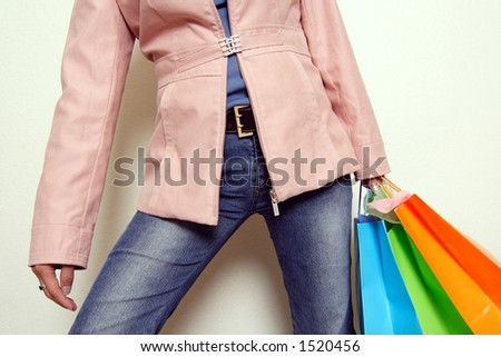 A woman carrying shopping bags - stock photo
