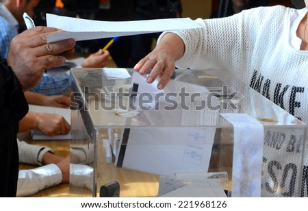 A woman casts his vote at a polling station in Sofia October 5, 2014. Bulgaria  - stock photo