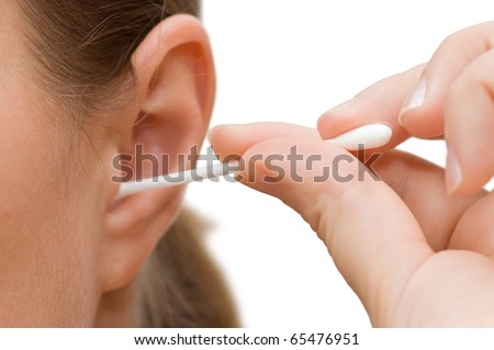 A woman cleaning her ear with cotton swab - stock photo