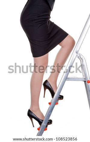 a woman climbs in the management of the career ladder. more women in senior positions. - stock photo