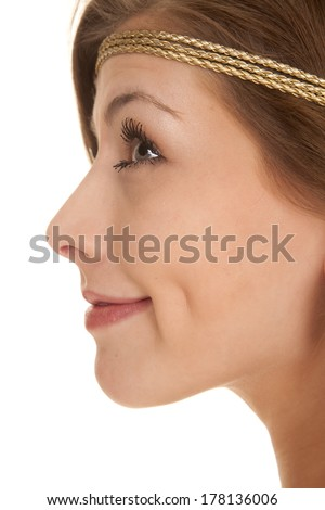 A woman close up face with a smile wearing a headband. - stock photo