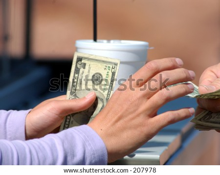 A woman collects the money for a beverage purchase