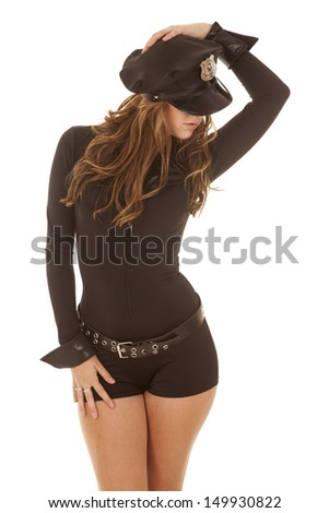A woman cop looking sexy wearing a hat. - stock photo