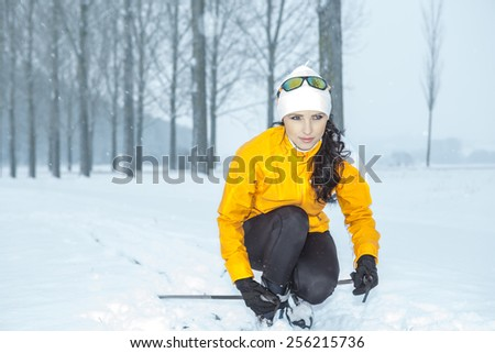 A woman cross-country skiing in the Alps - stock photo