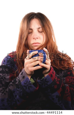 A woman desperately needs her first cup of coffee for the day. - stock photo