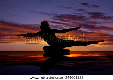 a woman doing a fitness pose holding it to strengthen her body. - stock photo