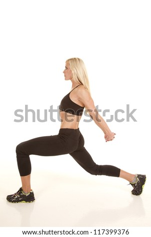 a woman doing some stretches to make her body flexible - stock photo