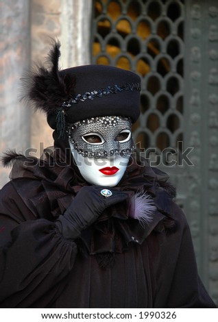 a woman dressed for Mardi Gras Carnivale in Venice Italy,St Marks Square - stock photo