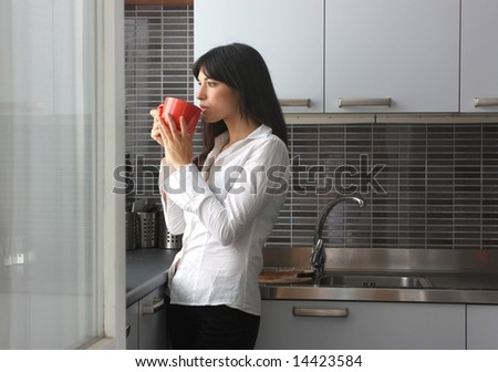 a woman drink a cup of tea