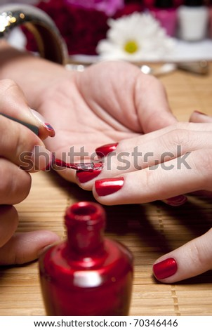 A woman enjoying a manicure. - stock photo