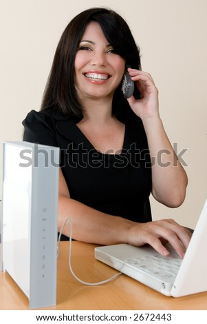 a woman enjoys the freedom of wireless networking and phone calls - stock photo