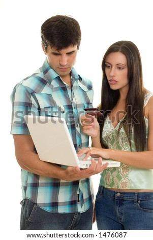 A woman enters credit card details.  Purchasing over the internet. - stock photo