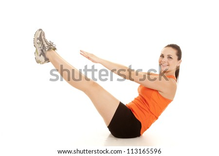 a woman exercising and doing some yoga strength training - stock photo