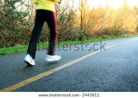 A woman exercising and running in the afternoon - stock photo