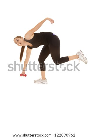 A woman falling forward and only holding on to a weight. - stock photo