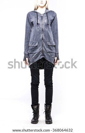 A woman(female, girl, model) wearing grey sweater(shirts, top, hood), black pants(jeans, denim, trousers), black boots(walker) close up isolated white at the studio. - stock photo