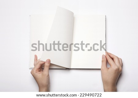 A woman(female) two hands hold a empty(blank) book(note, diary) spread(unfold) isolated white, top view, studio. - stock photo