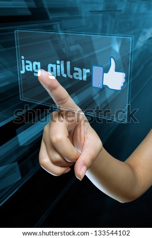 a woman finger select and like  on a swedish language digital screen