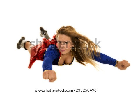 a woman flying through the air with a smile on her face. - stock photo
