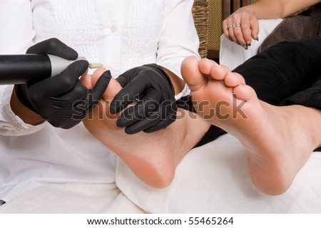 A woman gets a pedicure