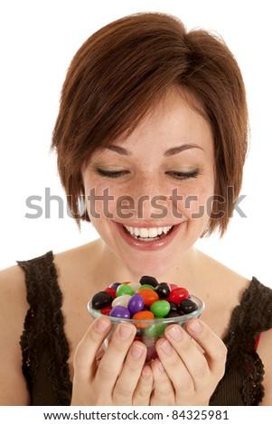 a woman getting ready to enjoy a bowlful of jelly beans.