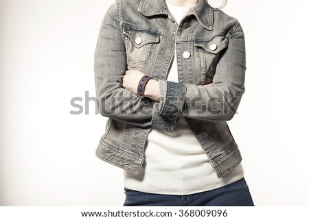 A woman(girl, female, model) wearing grunge blue denim(jeans) jacket and pants(trousers) stand up, make a pose isolated white at the studio.