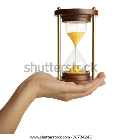 A woman hand holding a hourglass - stock photo