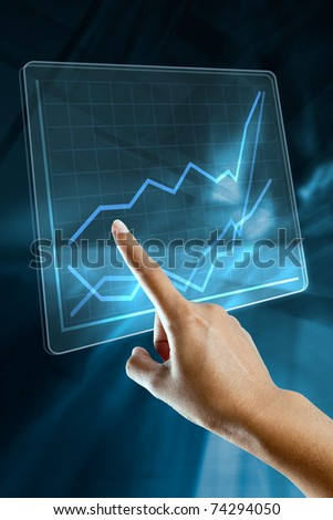 a woman hand make a graph on a digital screen
