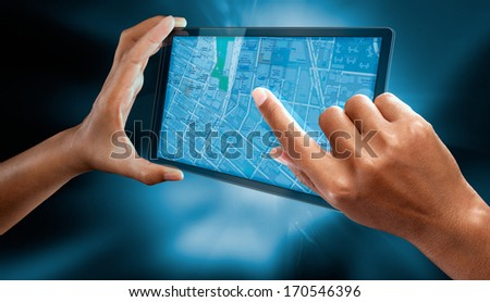 a woman hands read a map on a tablet  - stock photo