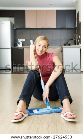 A woman has just  finished cleaning up a flat - stock photo