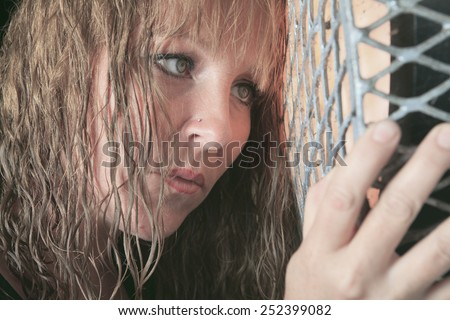 A woman having bad time in a tunnel - stock photo