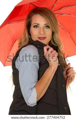 a woman hiding under her umbrella with a sensual expression. - stock photo