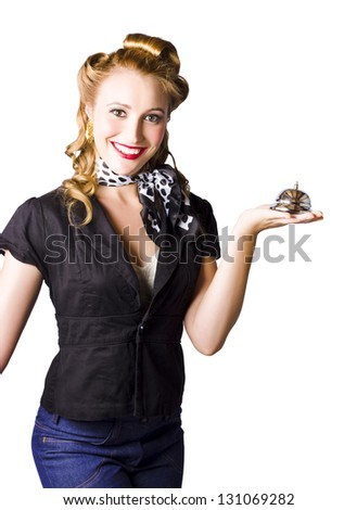 A woman holding a calling bell, concept of old fashioned service with a smile. - stock photo