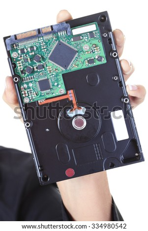 A Woman holding a hard drive disque. - stock photo
