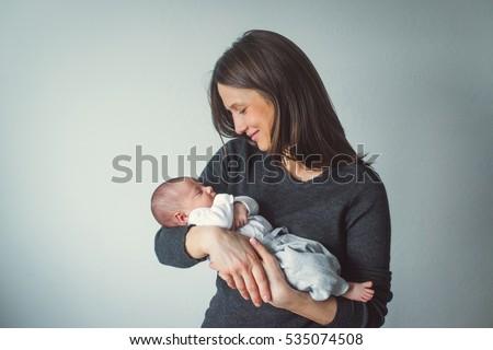 Woman Holding Newborn Mom Baby Closeup Stock Photo ...